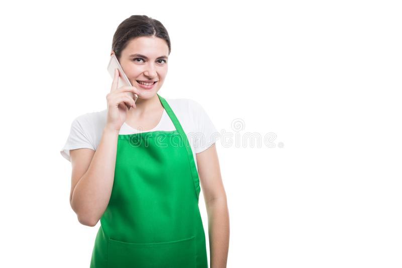 Successful female clerk making a call royalty free stock photography