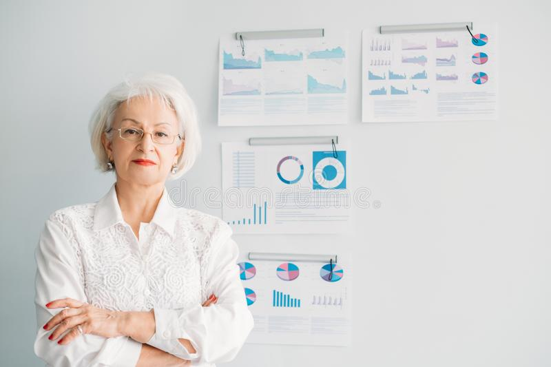 Successful female leader woman head department. Successful female leader. Head of department. Portrait of confident senior woman standing at whiteboard with stock photo