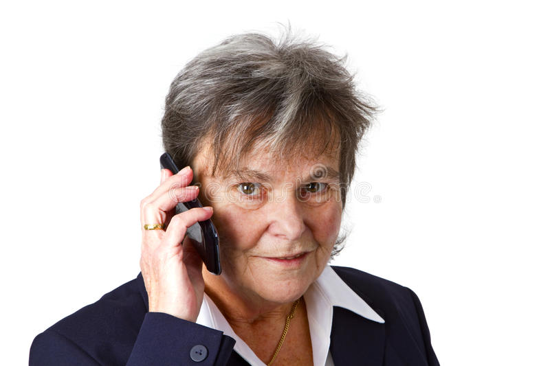Successful female senior with cellphone stock photography