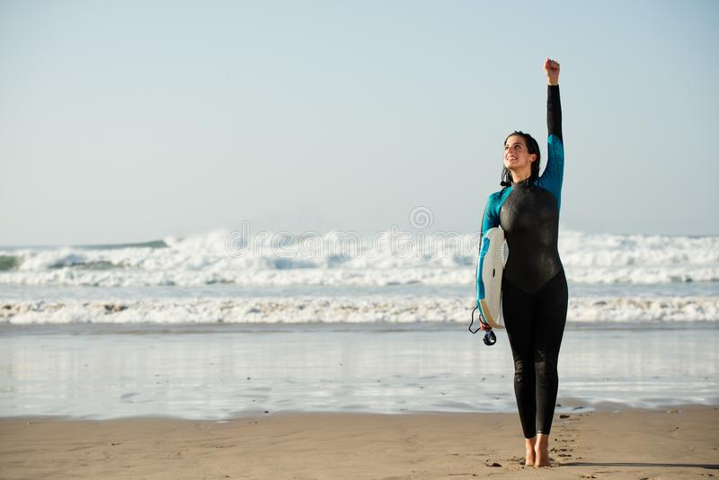 Surfer woman having fun with bodyboard at the beach royalty free stock photo