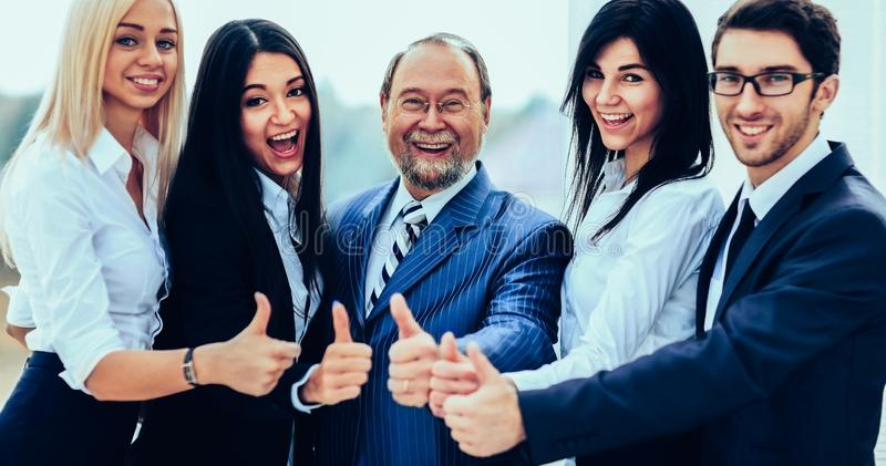 Successful friendly business team on office background royalty free stock photos