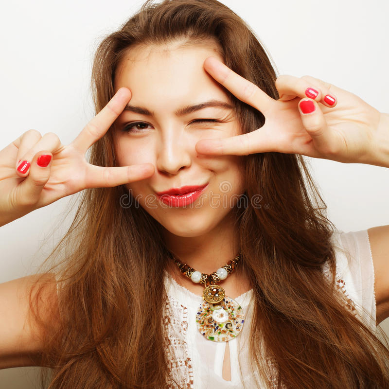 Successful girl gives thumb up with two hands stock photo