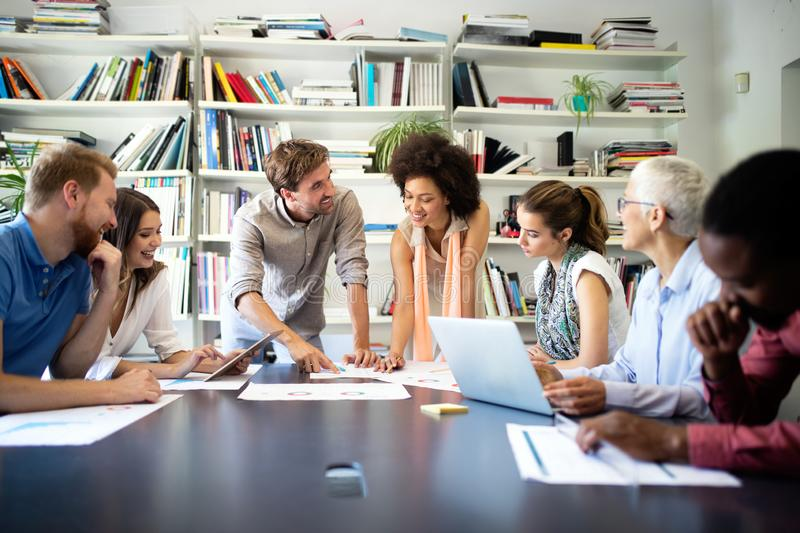 Successful group of business people at work in office stock image