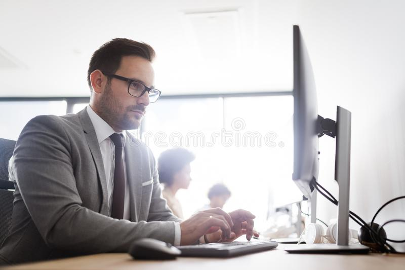 Successful group of business people at work in office royalty free stock photos