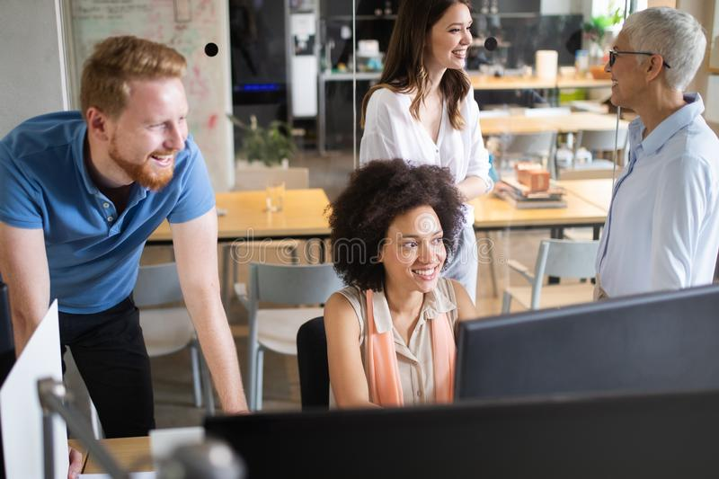 Successful group of business people at work in office stock images