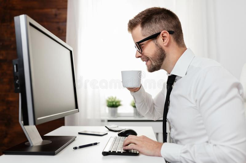 Successful businessman working in his office royalty free stock photography