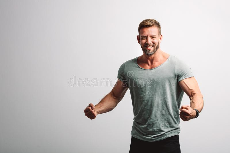 Successful handsome man on white wall stock images