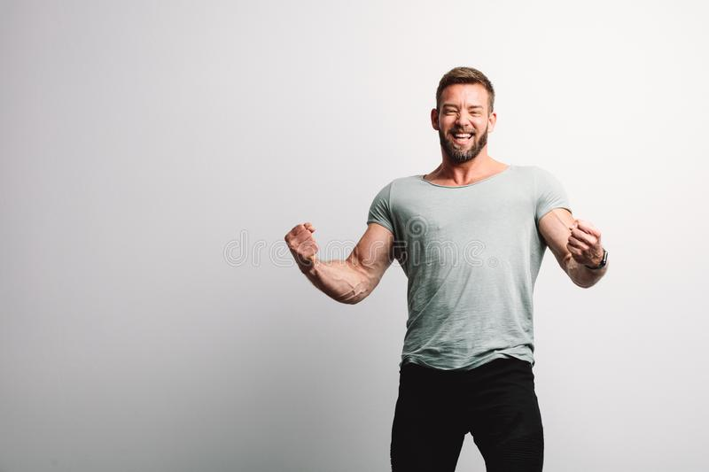 Successful handsome man on white wall royalty free stock photo