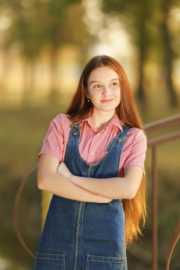 Successful happy beautiful long haired teen girl with a smile royalty free stock image
