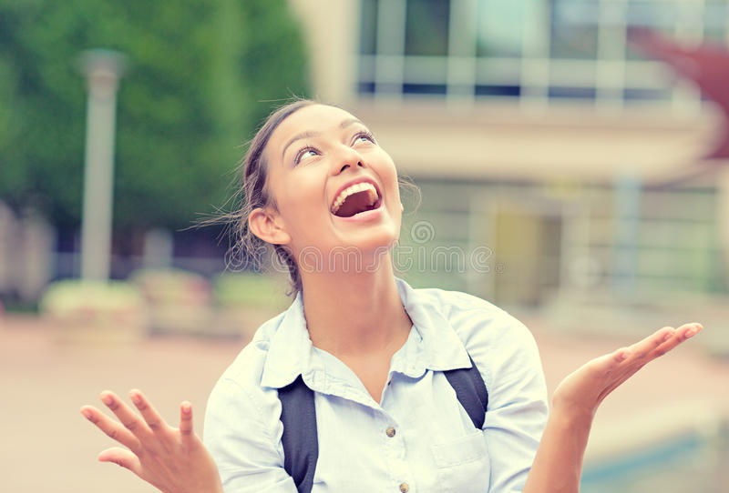 Successful happy business woman with arms up celebrating victory stock photo