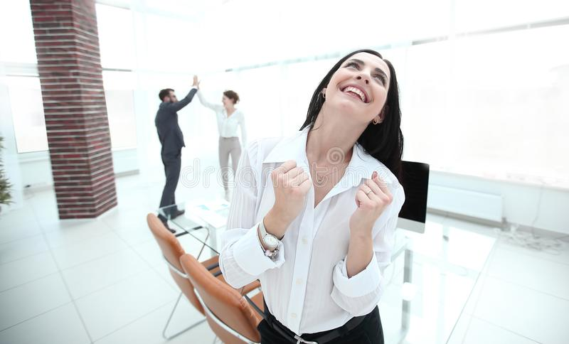 Successful happy business woman sitting at the desk. royalty free stock images