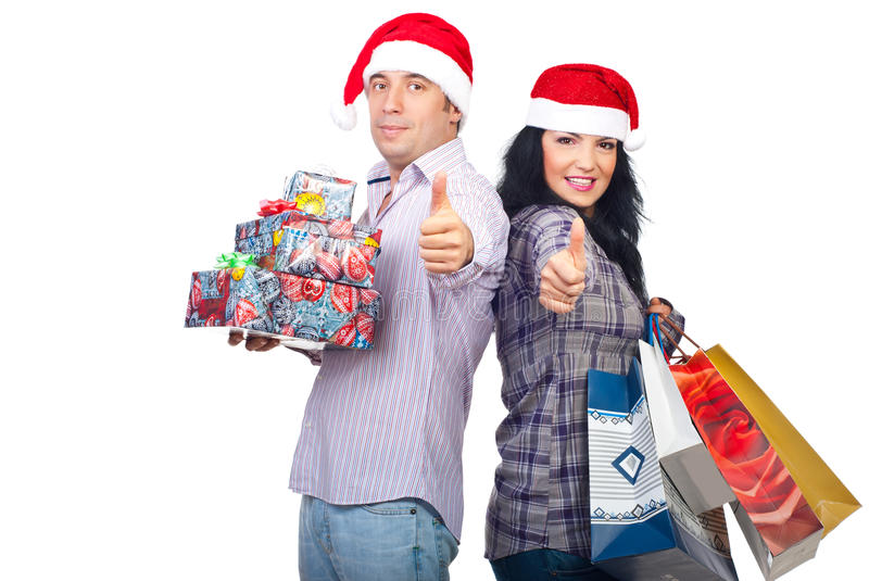 Successful happy couple with Christmas gifts royalty free stock image