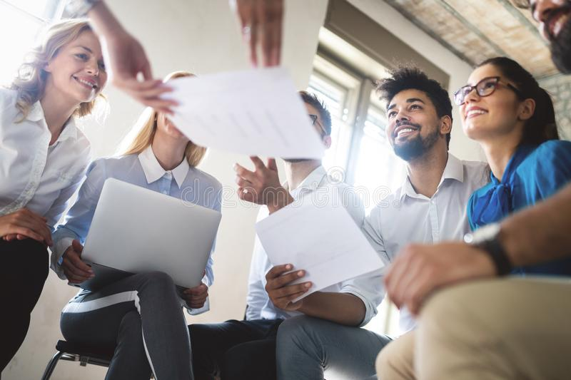 Successful happy group of people learning software engineering and business during presentation royalty free stock photo