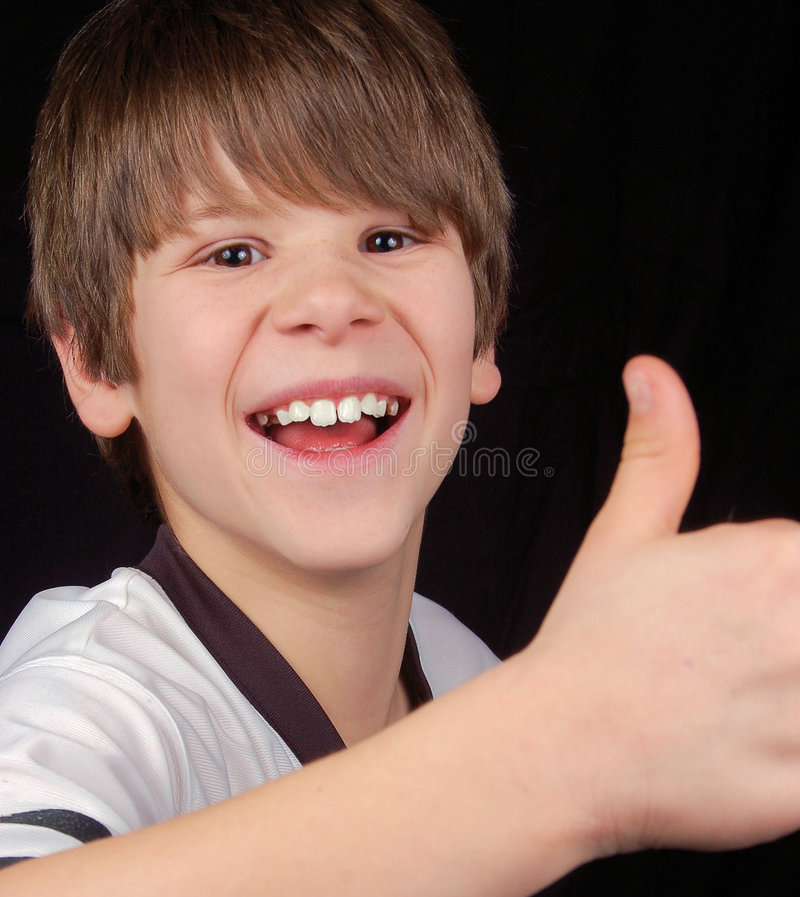 Successful Happy and Proud Boy. This boy is happy! Did his team win? Did he ace the test or get his first A? Either way, he's very proud stock photography