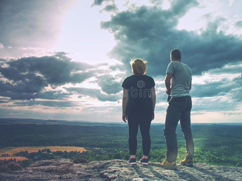 Successful Hiker woman hiking with friend standing on top stock photos