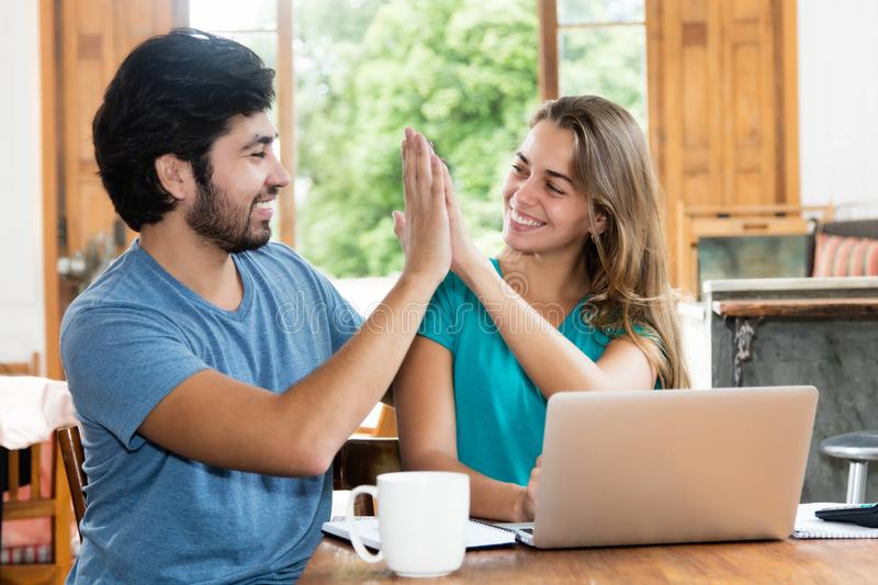 Successful hipster couple give high five stock photo