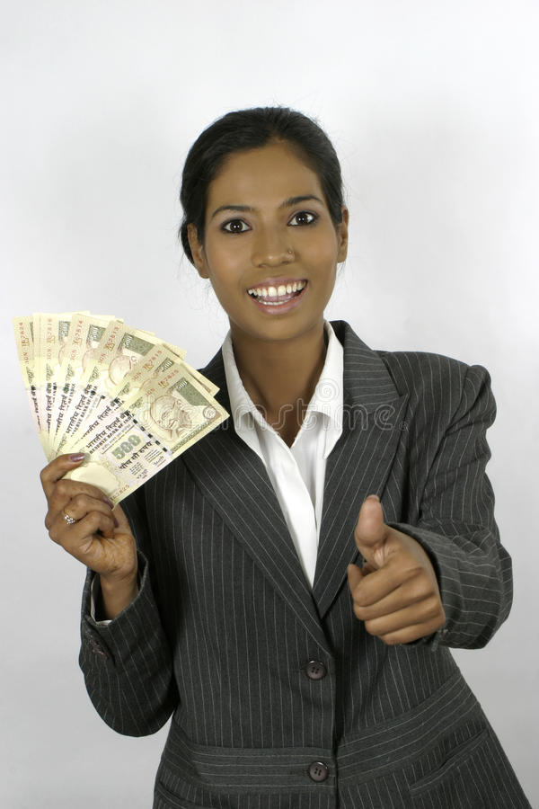 Successful indian business woman holding money royalty free stock photography