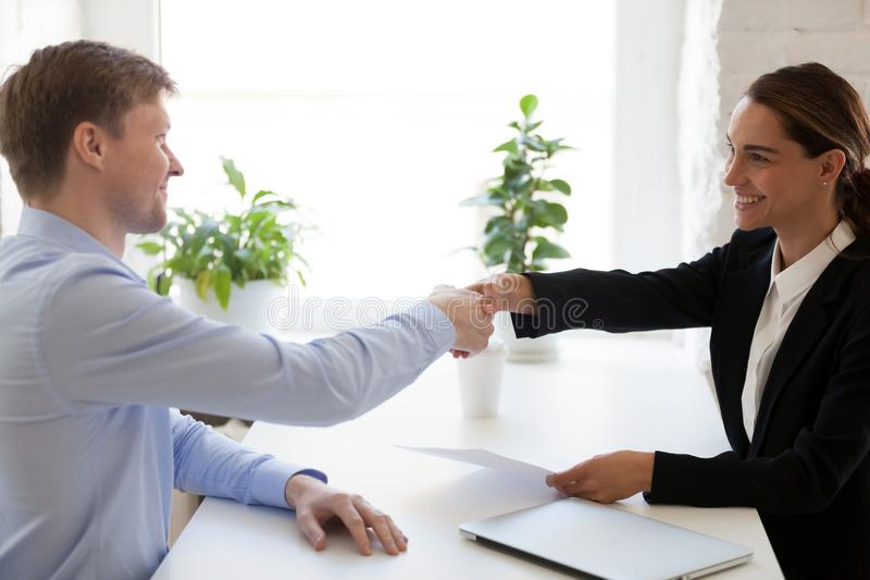 Successful job interview with boss and employee handshaking stock photography
