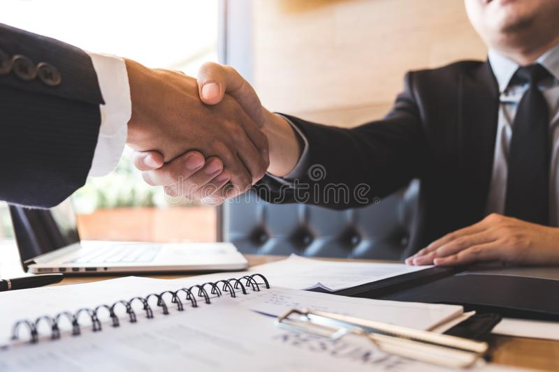 Successful job interview with boss and employee shaking hands after negotiation or interview, career and placement concept.  stock photography