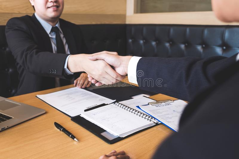 Successful job interview with boss and employee shaking hands af stock images
