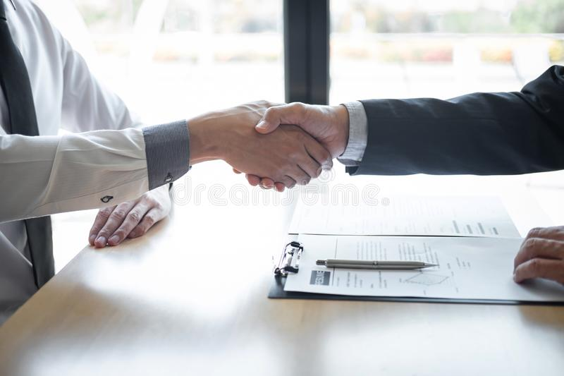 Successful job interview, Boss employer in suit and new employee shaking hands after negotiation and interview, career and stock images