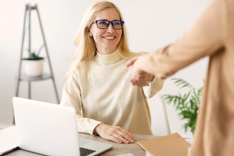 Successful Job Interview. Female Boss And Employee Handshaking royalty free stock photos