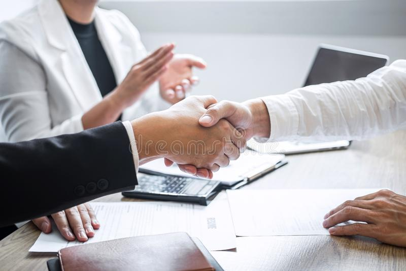 Successful job interview, Image of Boss employer committee or recruiter in suit and new employee shaking hands and clap after good stock image