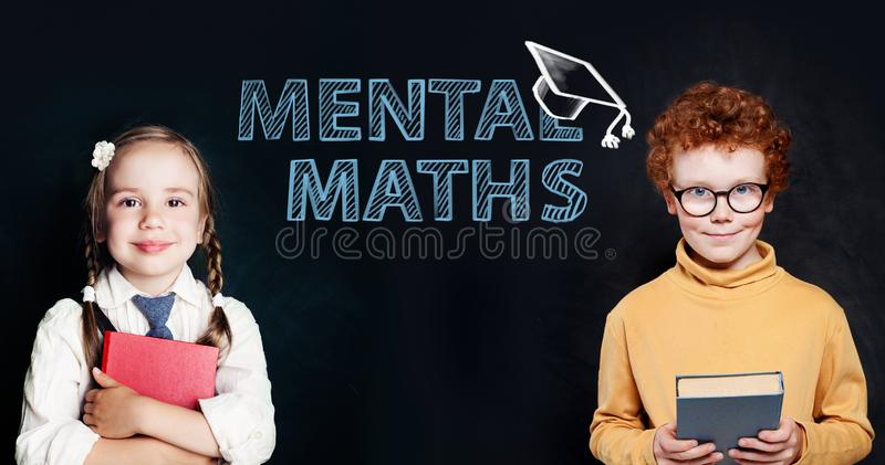 Successful kids boy and girl pupils on blackboard background with science and maths formulas. Mental maths concept royalty free stock photo