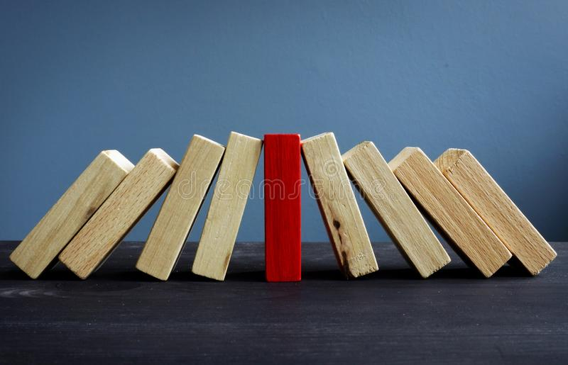 Successful leadership in business. Red and white wooden blocks royalty free stock photography