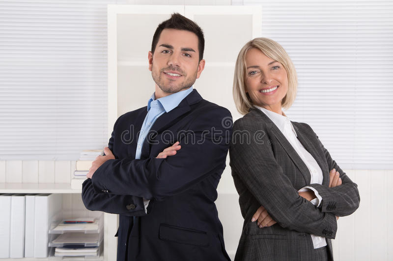Successful male and female business team: senior and junior managing director. stock image