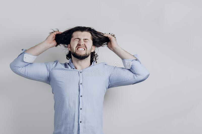 A Successful Man Is Angry And Tears His Long Hair. Stock