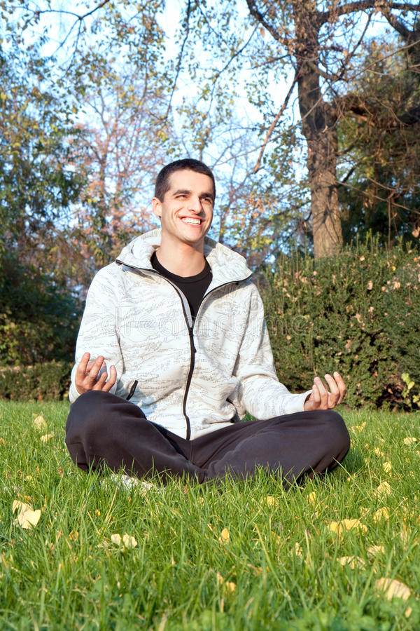 Successful man finding peaceful freedom in park stock images