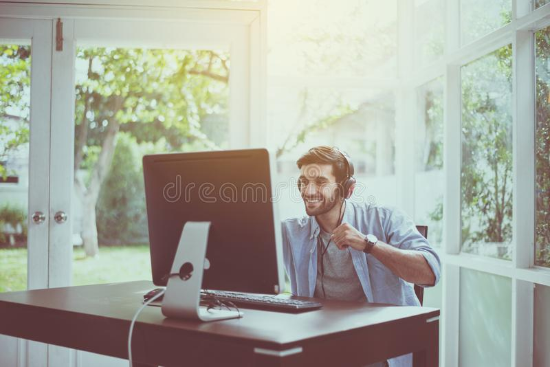 Successful man hands rais up with winner game online,Happy and smiling,Relax time royalty free stock photography
