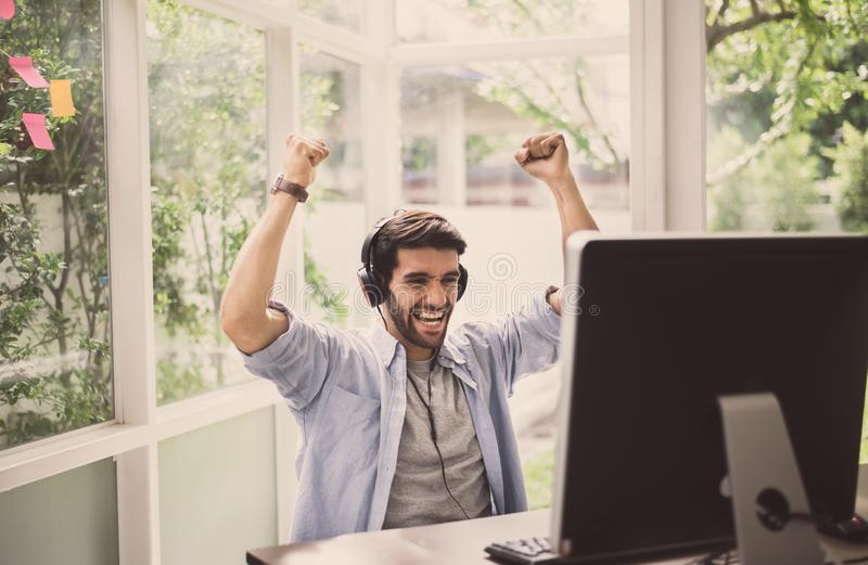 Successful man hands rais up with winner game online at home,Happy and smiling,Relax time royalty free stock photos