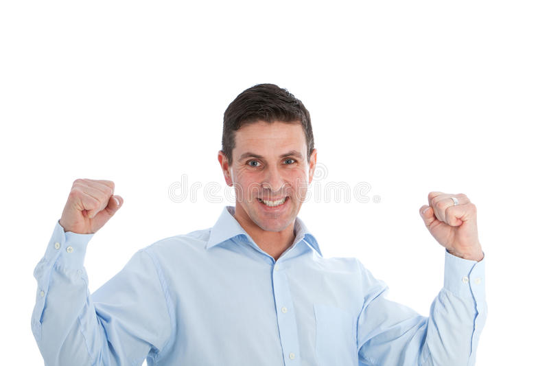 Successful Man Holding Arms Up in Clenched Fists stock photo