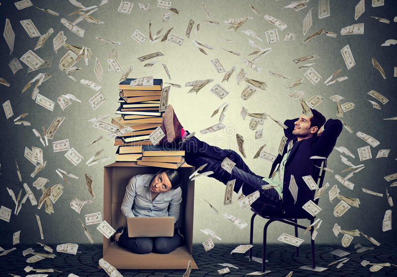 Successful man relaxing under cash rain with woman working on computer inside box. Successful educated men boss making money relaxing under cash rain in his royalty free stock images
