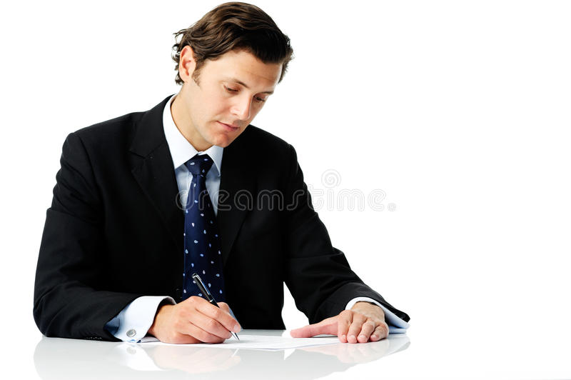 Successful man signing a contract royalty free stock images