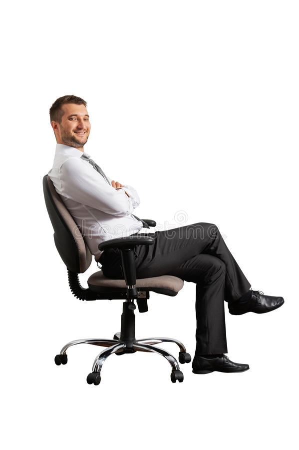 Successful man sitting on the office chair royalty free stock photos