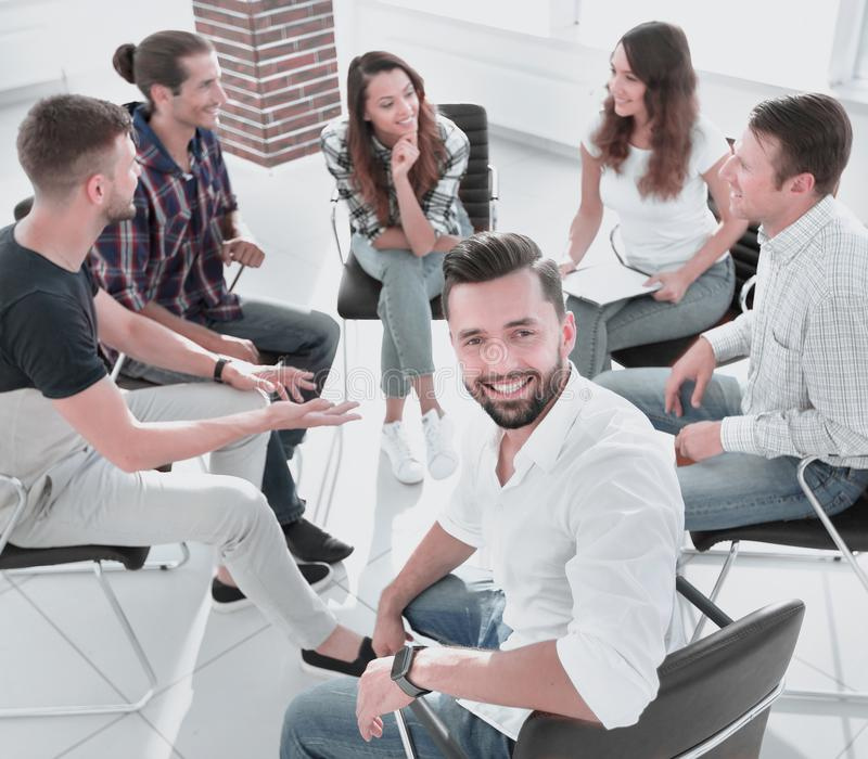 Manager and his team sitting in the office. Successful Manager and his team sitting in the office stock photography