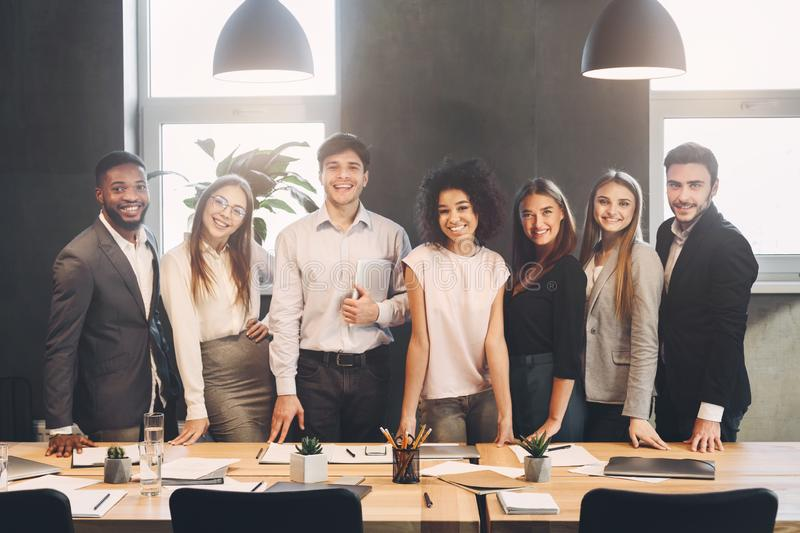 Successful managers posing and looking at camera in office royalty free stock photo