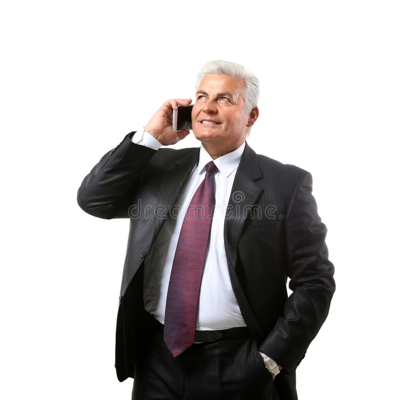 Successful mature businessman with mobile phone, isolated on white stock image
