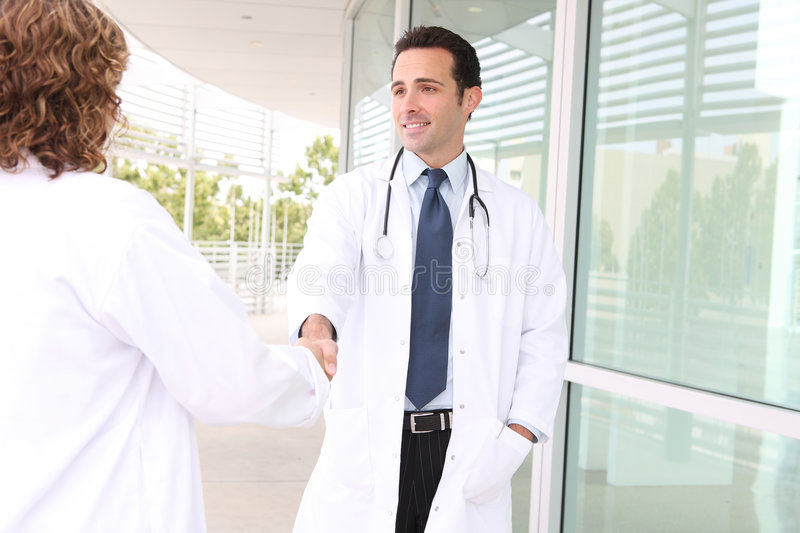 Successful Medical Team Handshake stock photo