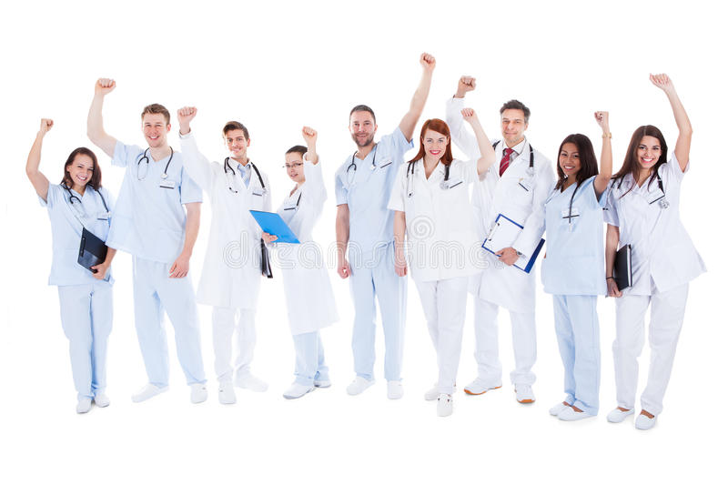 Successful medical team standing cheering royalty free stock images