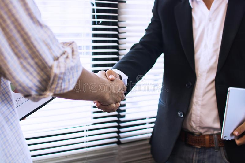 successful negotiate and deal concept, shake hands and business people in offce stock photography