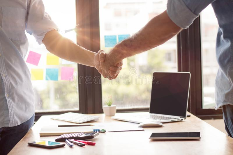 successful negotiate and handshake concept, two businessman shake hand with parthner to celebration partnership and teamwork, stock photos
