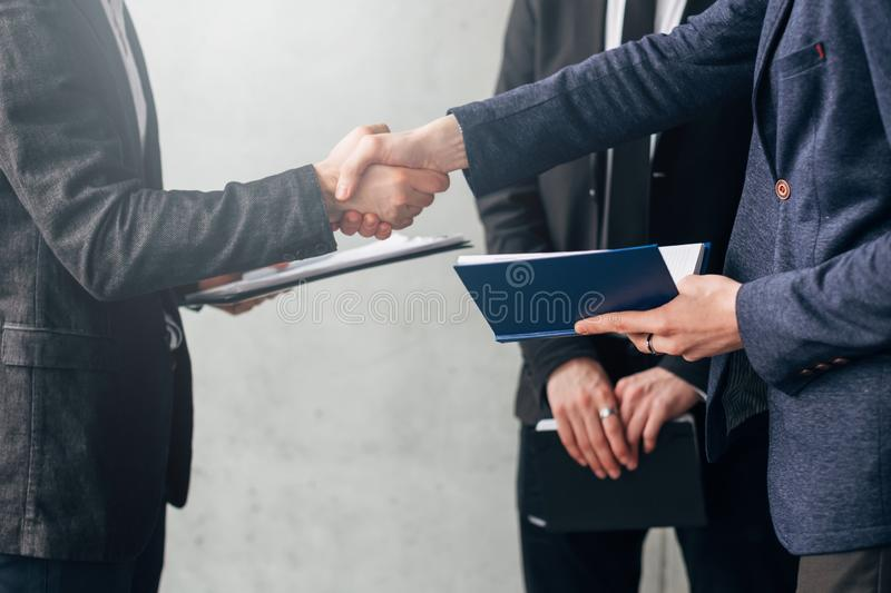 Successful negotiation business partners handshake stock images