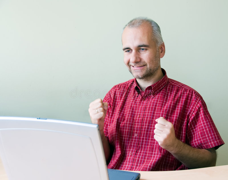 Successful office worker. Working at the desk with laptop stock image