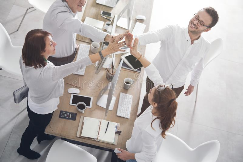 Successful office workers with business table royalty free stock photos