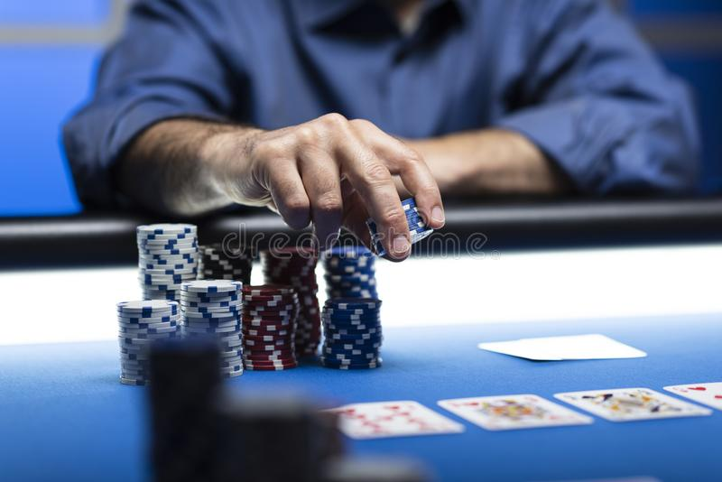 Successful player betting chips at casino royalty free stock photography