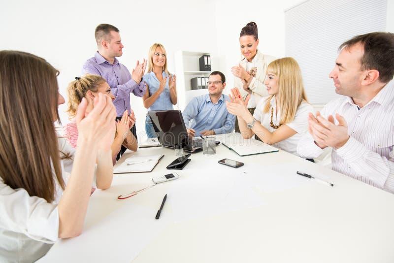 Successful Presentation. Successful business team congratulates colleague on Successful Presentation with big applauding royalty free stock photos